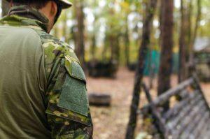 Army man walking in woods