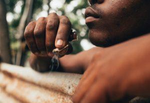 Jamaican man smoking joint