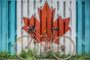 bike leaning on wall with Canadian graffiti