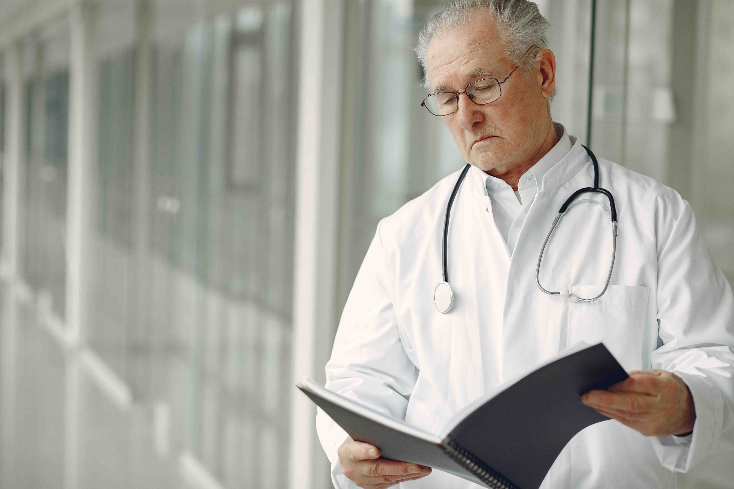 doctor looking at his notes