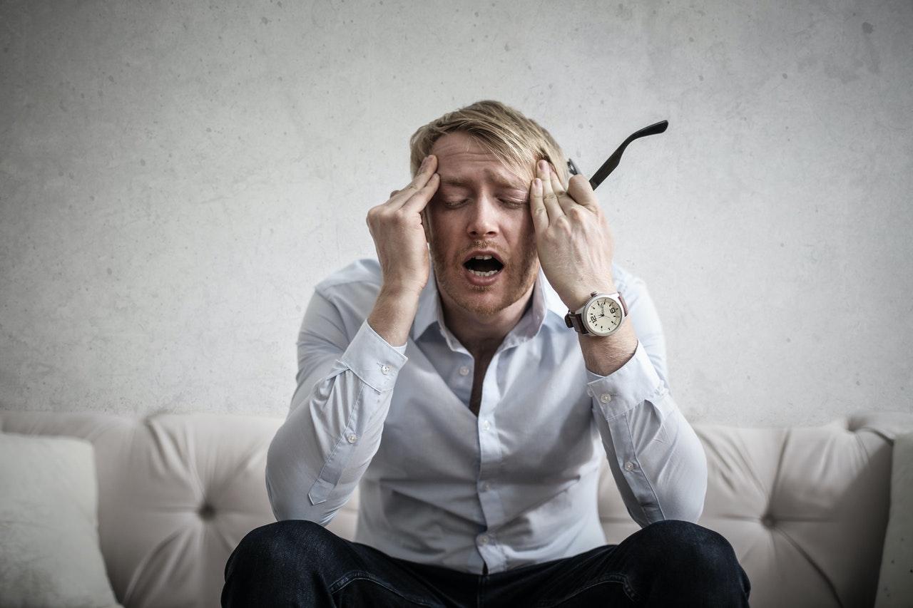 man sitting in distress