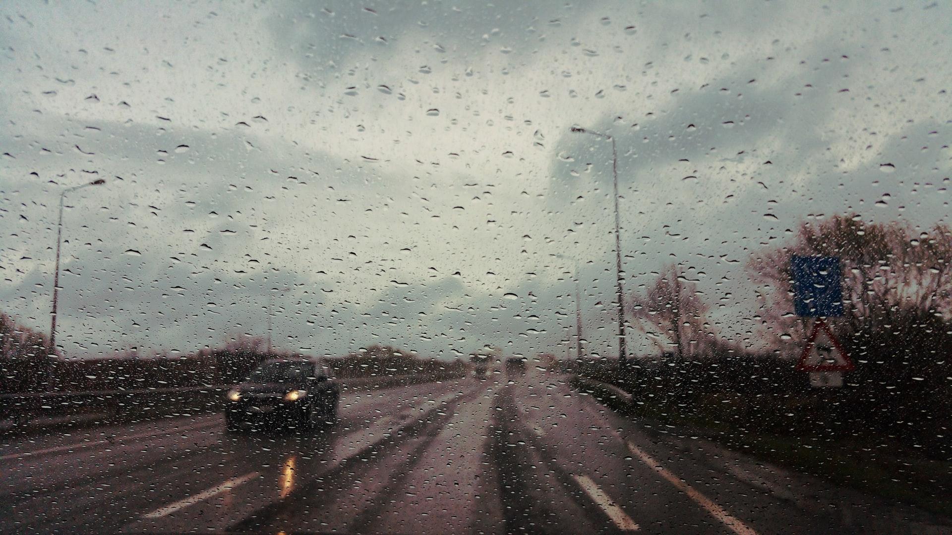 rainy road through car windscreen