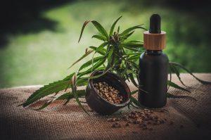 small black bottle and hemp seeds