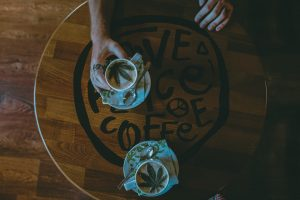 2 cups of cannabis coffee on cafe table