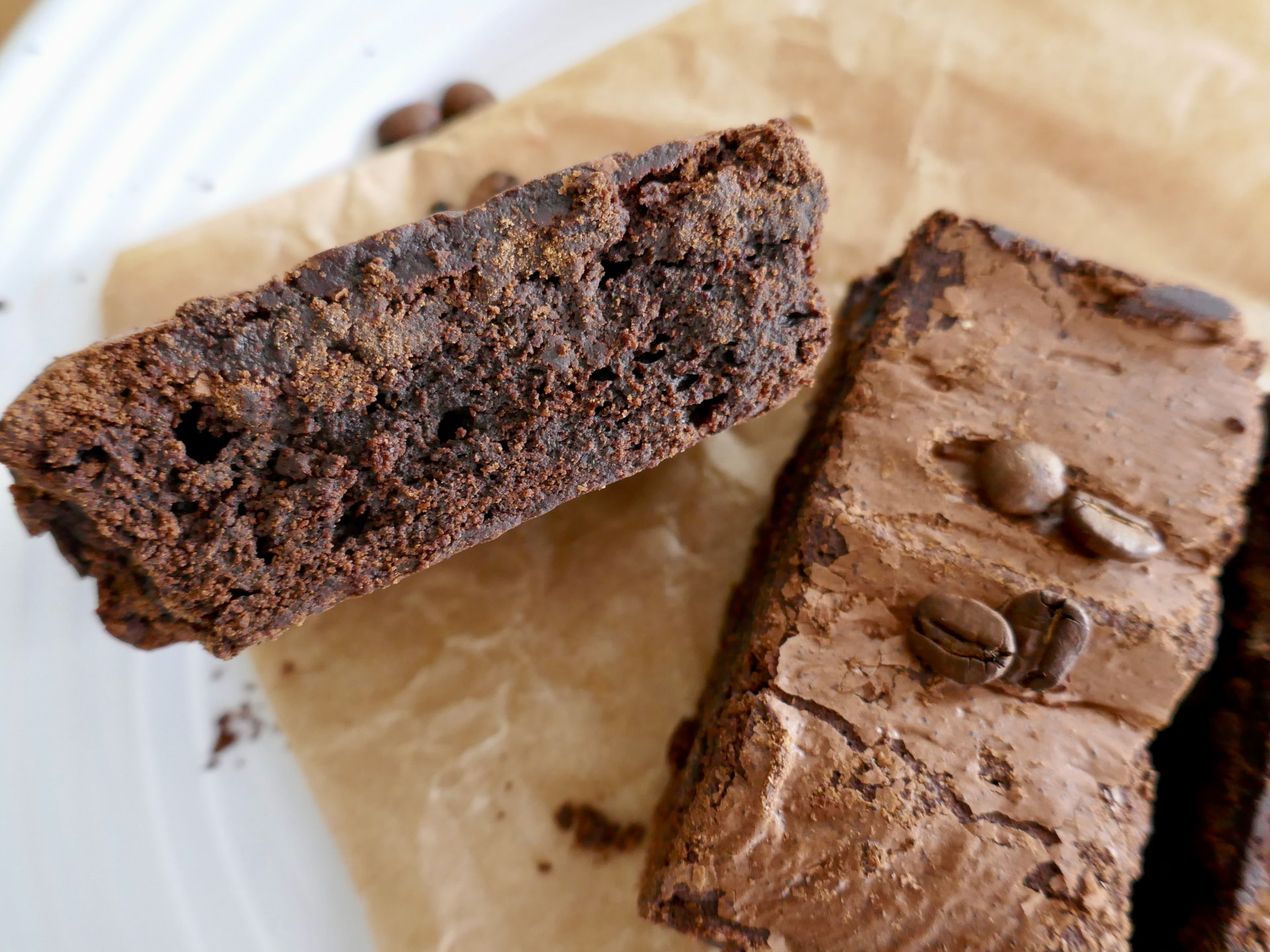 2 slices of chocolate brownie on wooden board