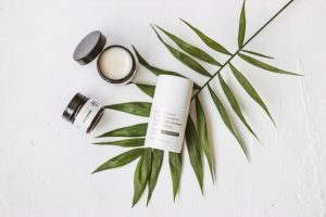 CBD beauty products on top of leaf