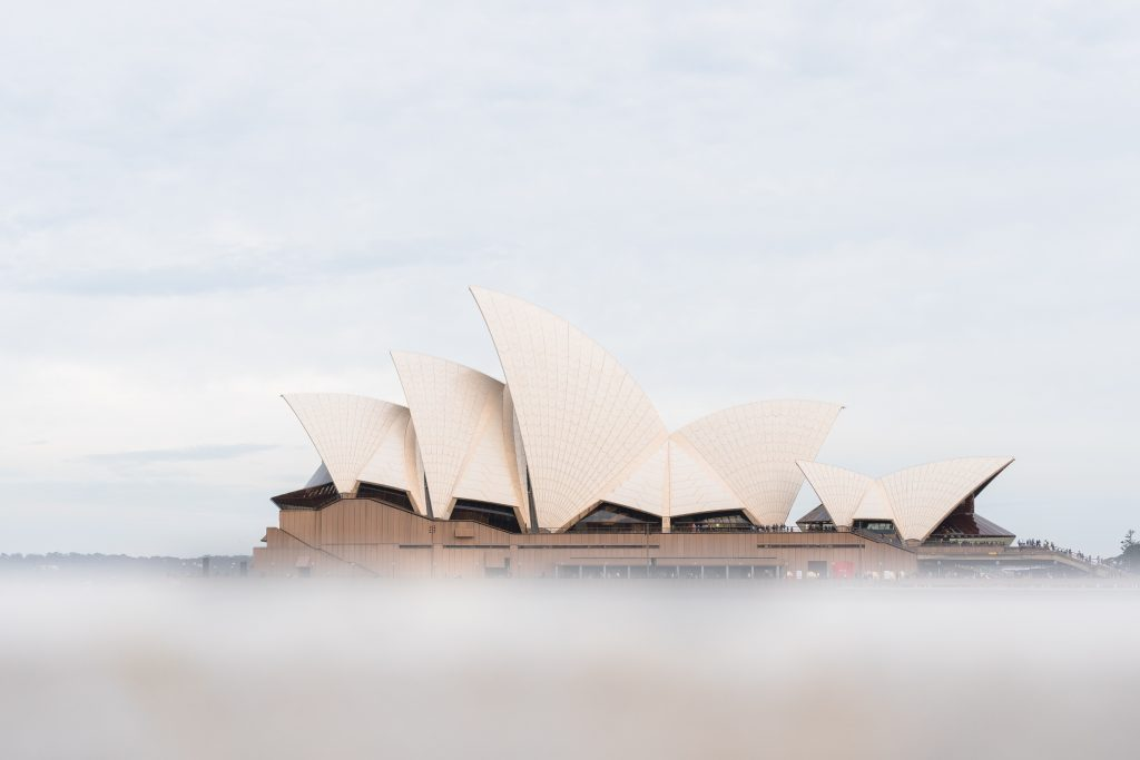 Sydney opera house through clouds