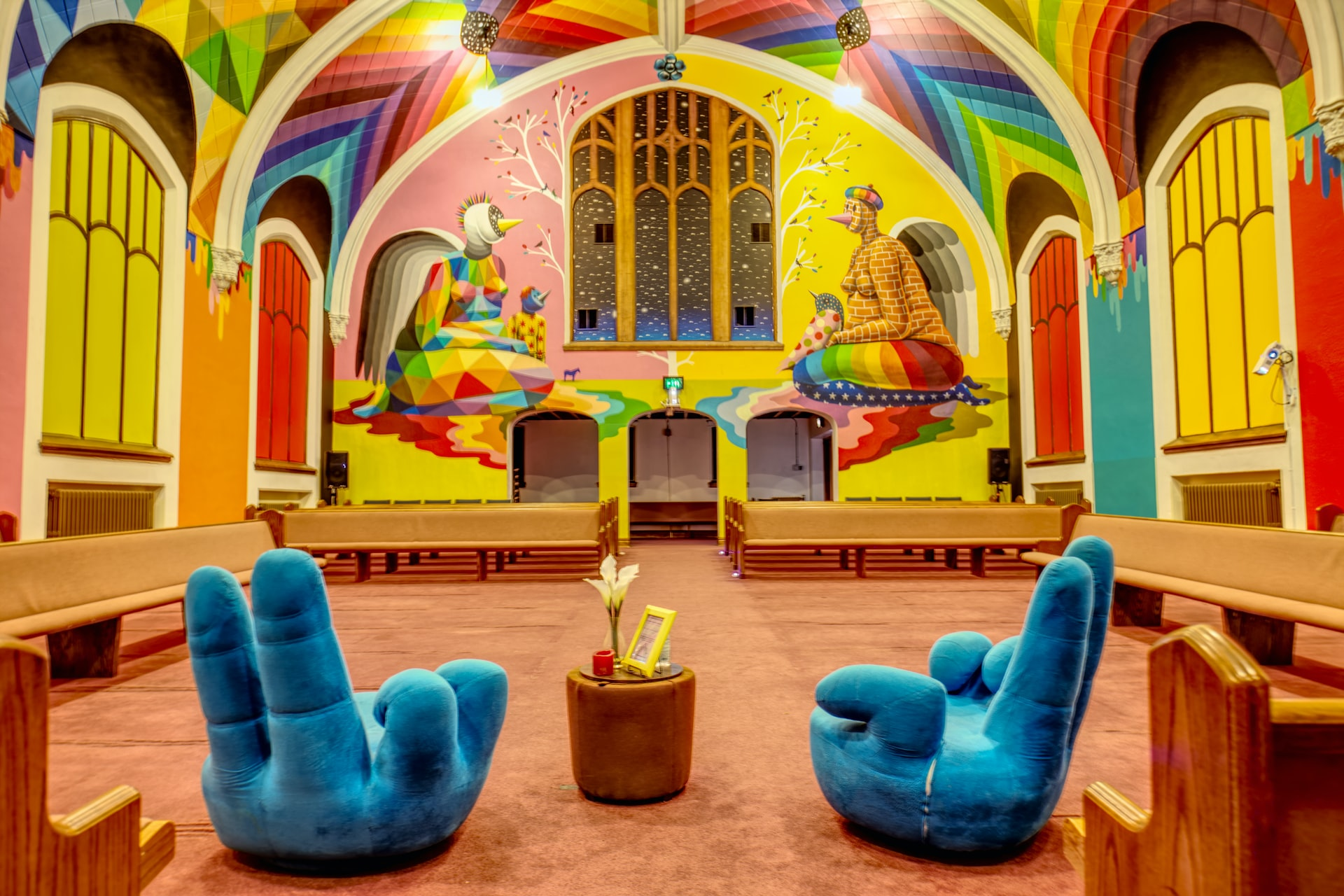 colourful decorations and funky chairs inside church of cannabis