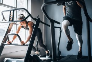male and female on gym equipment