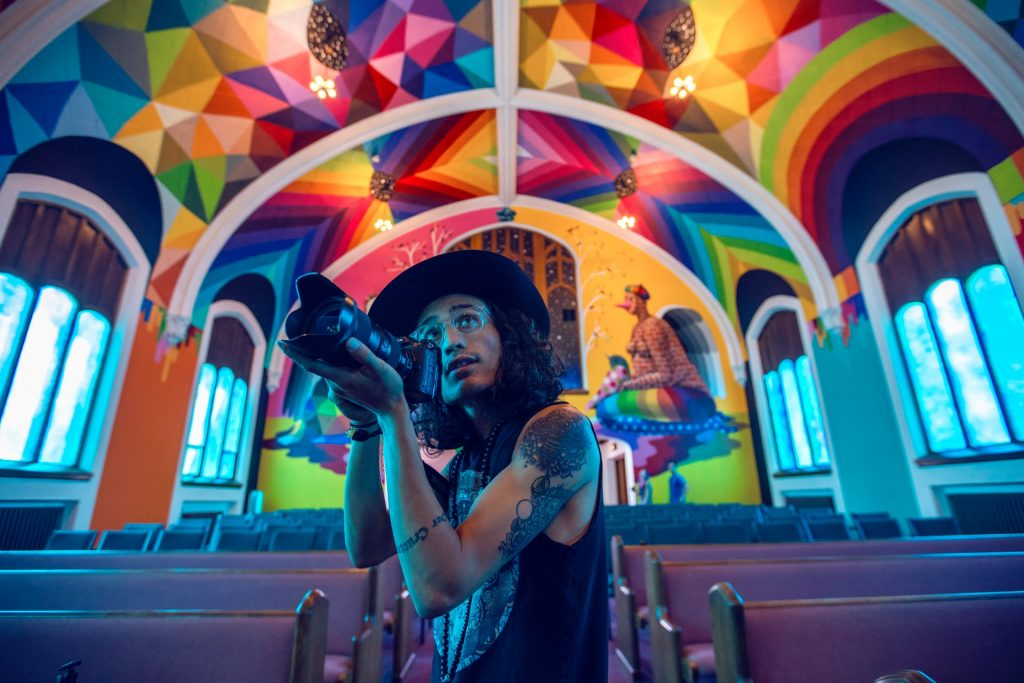 person with camera inside international church of cannabis