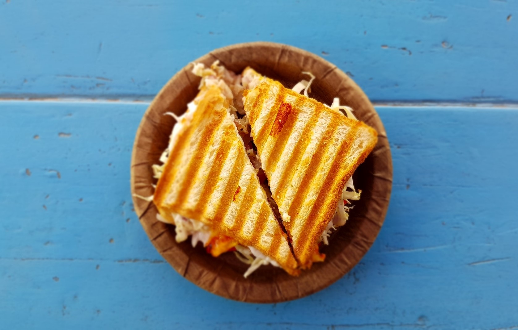 sandwich on a blue table