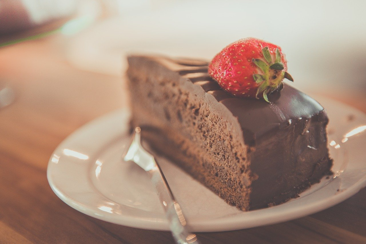 slice of chocolate cake with strawberry on top