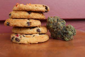 stack of cookies next to marijuana bud