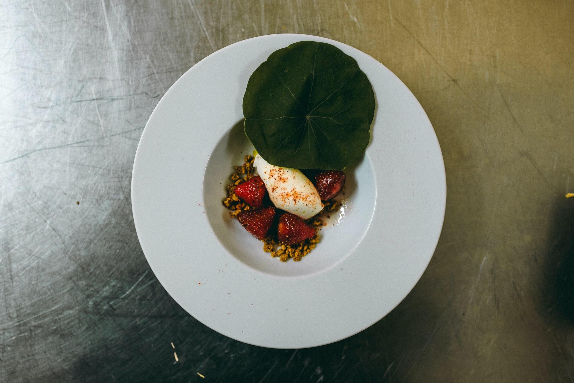 strawberry panna cotta in white bowl