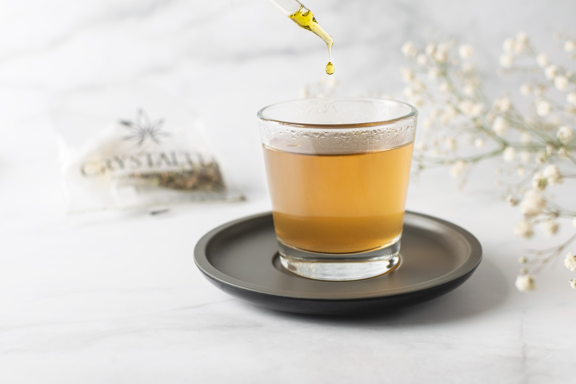 tea in a glass on white surface