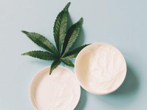 body cream with cannabis leaf