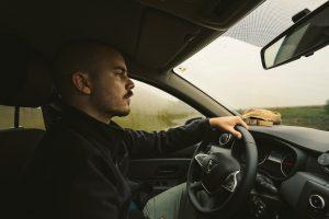 man in car driving