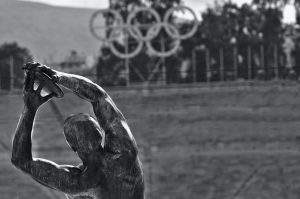 statue with olympic rings