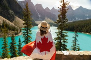 woman with canadian flag wrapped around her